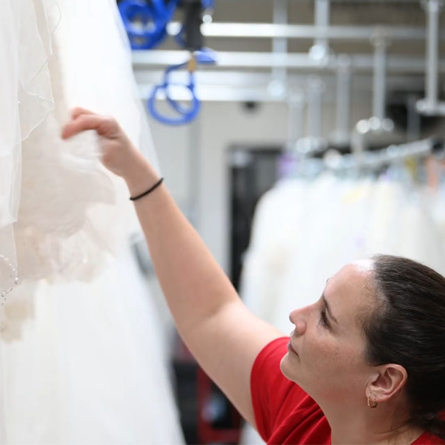 examining a gown for restoration