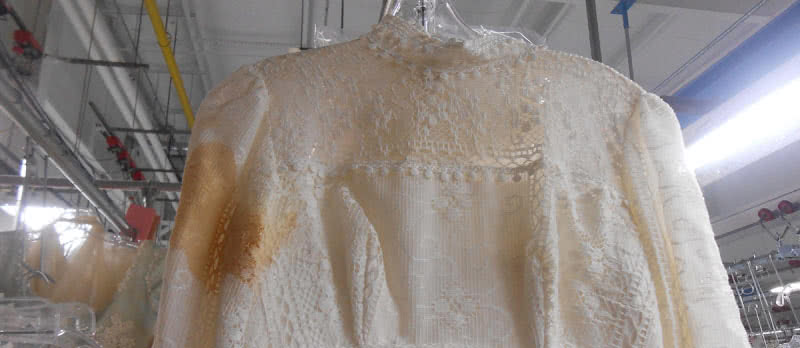 yellowed wedding gown sleeve